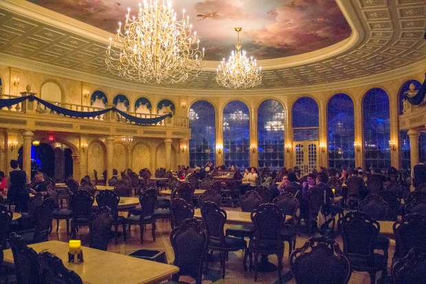"The main ballroom, with its elegant chandeliers, is one of the three dining areas that make up the Be Our Guest restaurant. The dining establishment is based on the rooms in the Beast's castle as seen in the Disney animated movie ""Beauty and the Beast"" and is located in Fantasyland at the Magic Kingdom of the Walt Disney World Resort. (Photo by Mark Eades, Orange County Register/SCNG)"