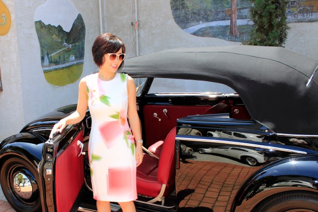 Vanna Nguyen checks out a vintage VW bug convertible at the VW d'Elegance car show at Old World Village in Huntington Beach. COURTESY BRIAN STANLEY