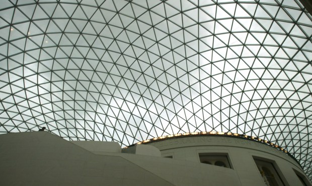 favorite.xxxx.mgk1.jpg 4/2004 photo by Michael Kitada / The Orange County Register The British Museum features The Queen Elizabeth II Great Court which is a covered square at the centre of the British Museum designed by the architects Foster and Partners. The Great Court opened in December 2000 and is the largest covered square in Europe. The roof is a glass and steel construction with 1,656 pairs of uniquely shaped glass panes. This image appeals to me due to the scope of the structure and how small the figure is in the left bottom quadrant. Man's acheivement covering man's history.