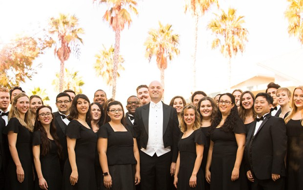 Robert Istad, center, leads the University Singers, who this school year recorded with composer John Williams two pieces created for Steven Spielberg movies. (Photo courtesy of Cal State Fullerton)