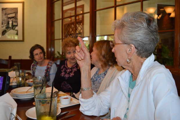 Aloha Saxon, right, talks to other members of the Our Neck of the Woods at the women's-only luncheon at Olive Garden on May 8. (Photo by Emily Rasmussen, contributing photographer)