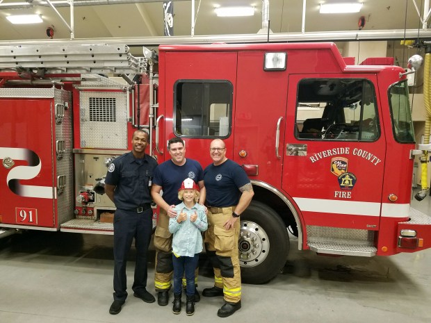 Ally Hatch, 11, visited Moreno Valley Fire Station 91 to thank the firefighters who responded to her near-drowning. When firefighters arrived, Ally's mother and grandfather were giving her CPR. Courtesy of Cal Fire/Riverside County Fire Department