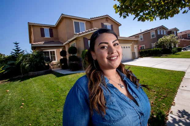Liz Arevalo is a millennial who lives with her parents in order to work and go to school full time She is pictured in front of her parents home in Eastvale on Tuesday, June 20, 2017. (Photo by Paul Rodriguez, Orange County Register/SCNG)