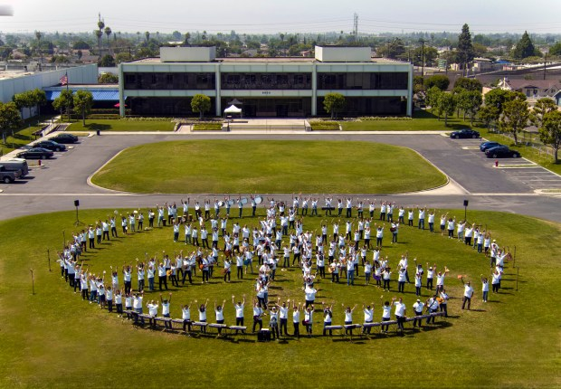 "Yamaha Corporation of America employees form the shape of the company's logo on the lawn of their headquarters in Buena Park on Make Music Day 2017, while playing and singing ""Twist and Shout."" (Photo courtesy: Yamaha Corporation of America)"