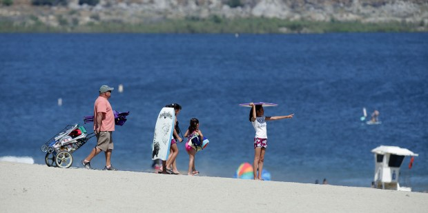 A family looks for just the right spot to set up for a day on the shore near the cool water of Lake Perris on a sunny afternoon in Perris, CA. Thursday, June 22, 2017. TERRY PIERSON,THE PRESS-ENTERPRISE/SCNG