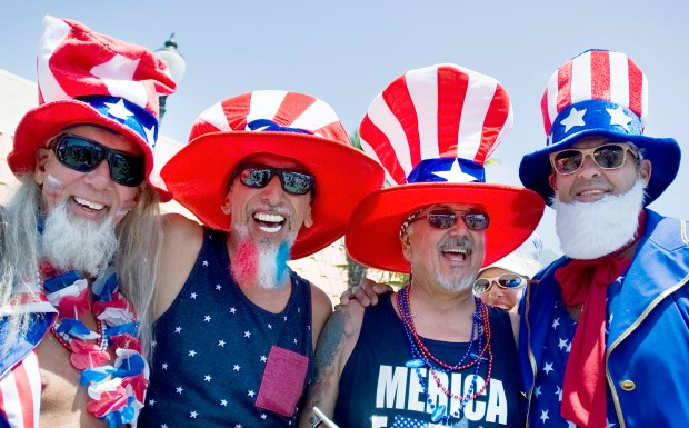 The Huntington Beach Fourth of July Parade brings out the inner Uncle Sam in people such as, from left, David Lasky, Ben Adams, Tony Huerta and Sammy Gallow. PHOTO MINDY SCHAUER,ORANGE COUNTY REGISTER