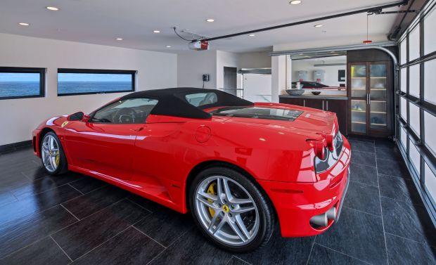 A Ferrari faces the windows in the garage at a beachfront Laguna Beach house. (Photo by Jeri Koegel)
