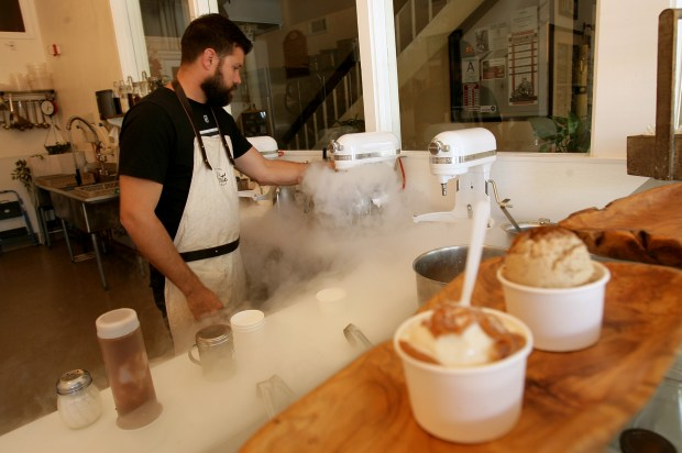 Ryan Berk, co-owner and chef of a_ la minute, demonstrates how he uses liquid nitrogen to make ice cream at his shop in Redlands on Thursday, June 6, 2013.