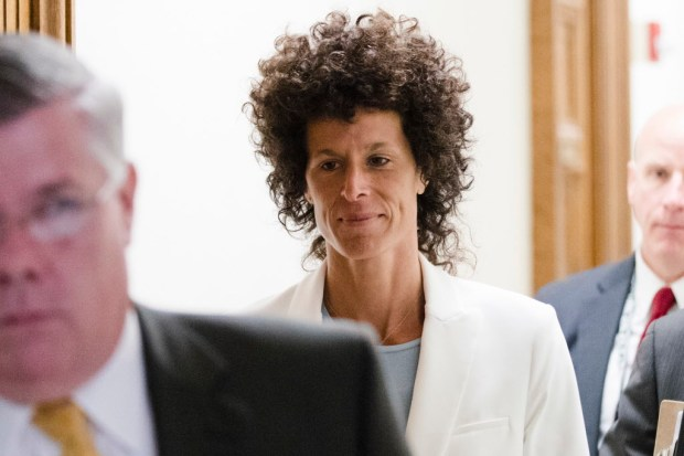 Andrea Constand walks from the courtroom during Bill Cosby's sexual assault trial at the Montgomery County Courthouse in Norristown, Pa., Tuesday, June 13, 2017. Cosby is accused of drugging and sexually assaulting Constand at his home outside Philadelphia in 2004. (AP Photo/Matt Rourke, Pool)