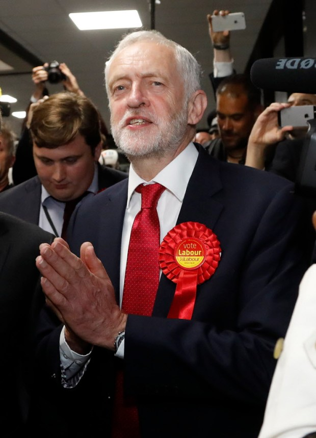 Britain's Labour party leader Jeremy Corbyn gestures as he arrives for the declaration at his constituency in London, Friday, June 9, 2017. Britain voted Thursday in an election that started out as an attempt by Prime Minister Theresa May to increase her party's majority in Parliament ahead of Brexit negotiations but was upended by terror attacks in Manchester and London during the campaign's closing days. (AP Photo/Frank Augstein)
