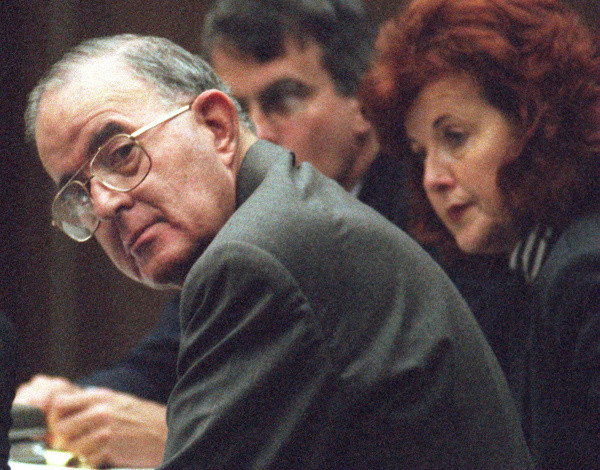 Former Orange county treasurer Robert L. Citron glances back at his wife, Terry Citron, moments after BOBPHOTO#1 11/19/96--Superior Court Judge J. Stephen Czuleger sentenced Citron to a year in county jail and a $100,000 fine Tuesday morning in Santa Ana. PHOTO BY MARK RIGHTMIRE