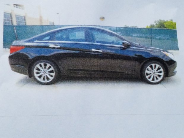 Colton police say Nicole Darrington-Clark, 43, of Colton, suspected of killing one granddaughter and injuring another and her daughter in a stabbing Monday, June 5, 2017, may be driving a black four-door 2013 Hyundai Sonata like this one. (Photo courtesy of Colton Police Department)