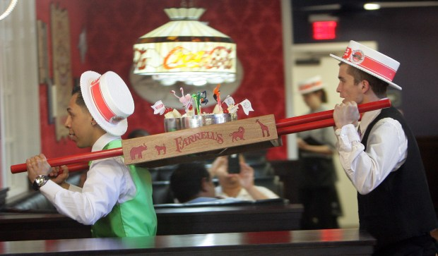 """A huge bowl of ice cream known as """"The Zoo"""" is carried around Farrell's Ice Cream Parlour in Riverside on Thursday, Jan. 31, 2013."""