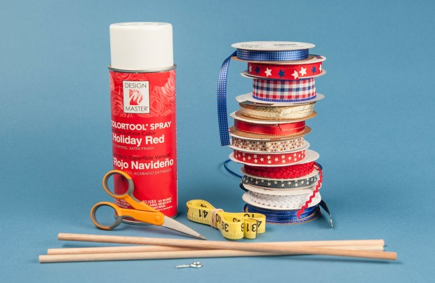 Materials needed for Fourth of July ribbon wand craft wood dowels, ribbon, eye screws, red spray paint, scissors and measuring tape. Wednesday, May 31, 2017. (Photo by Nick Agro, Orange County Register/SCNG)