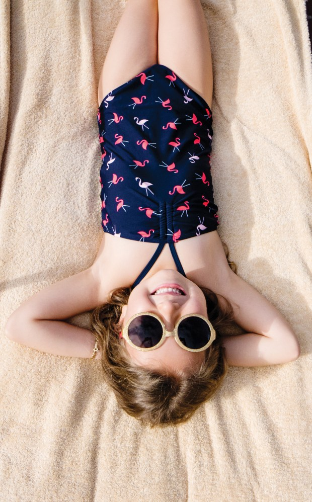 Chloe Hirth, 6, of Laguna Niguel lays out by the pool at the Montage Laguna Beach on Monday, May 15, 2017. (Photo by Raymona Chin, contributing photographer)