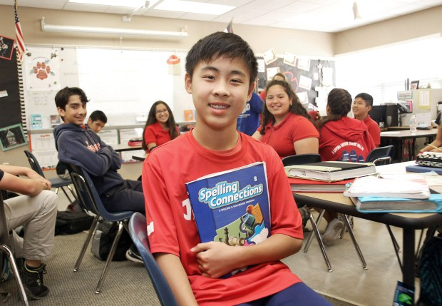 Daniel Chen, 13, poses in his English Literature class, at Loving Savior of the Hills school, in Chino Hills, CA., Thursday, May 19, 2016. Daniel is one of six Southern California News Group area students that will be participating in the Scripps National Spelling Bee next week. (Photo by James Carbone for the Inland Valley Daily Bulletin)