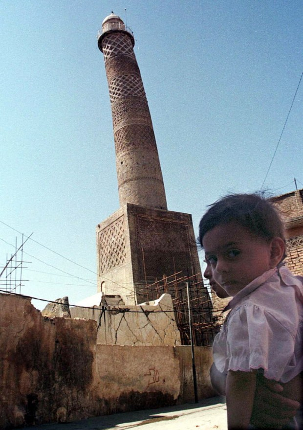 This Sept. 25, 1998 file photo shows the tilting al-Hadba minaret in Mosul, Iraq. Iraq's ministry of defense says IS destroyed the al-Nuri mosque in Mosul and the adjacent iconic leaning minaret when fighters detonated explosives inside the structures late Wednesday night on June 21, 2017. (AP Photo/Jassim Mohammed, File)