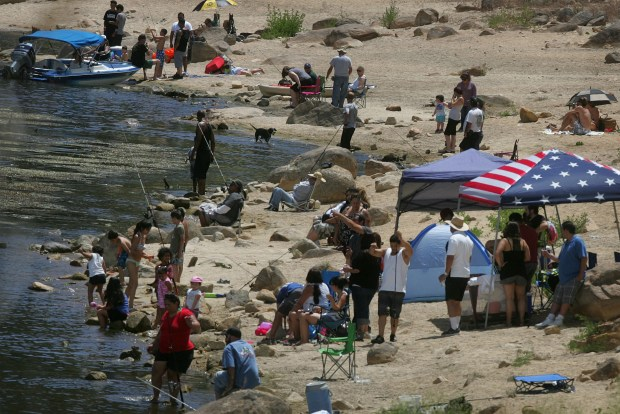 People recreate on the north shore of Big Bear Lake, on Sunday, June 19, 2016.