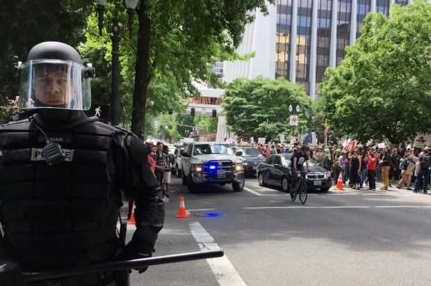 Thousands of protesters gather in Portland, Ore., Sunday, June 4, 2017, for competing rallies following last month's fatal stabbing of two men on a light-rail train by a man police say was shouting anti-Muslim slurs. A pro-Donald Trump free speech rally had been previously planned by a conservative group. Counter protests were organized by religious and labor groups. (AP Photo/Kristena Hansen) ORG XMIT: RPKH201