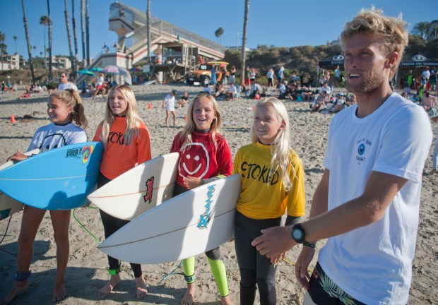 Professional surfer Patrick Gudauskas, who hosted the 5th annual Stoke-o-Rama along with his two pro surfer brothers, encourages girls in the 12-and-under division before their heat in Saturday's competition.PHOTO BY JEFF ANTENORE, CONTRIBUTING PHOTOGRAPHER