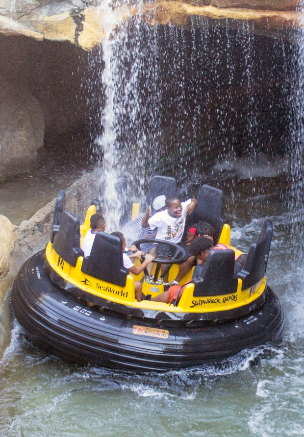 Riders pass under a waterfall on the Shipwreck Rapids ride almost guaranteeing that they will get soaked with water at SeaWorld San Diego. (Photo by Mark Eades, Orange County Register/SCNG)