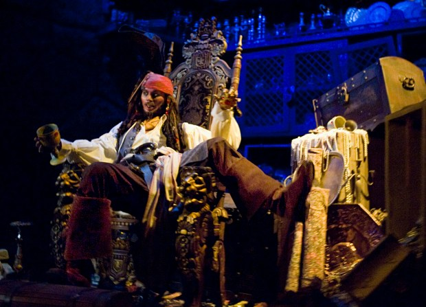 Captain Jack Sparrow enjoys some stolen wares inside Pirates of the Caribbean attraction at Disneyland. (File photo by Joshua Sudock, Orange County Register/SCNG)