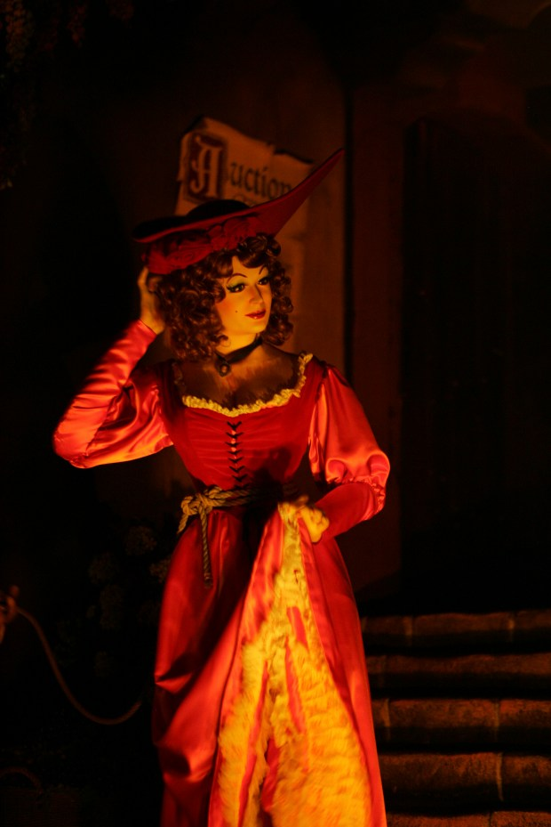 The Redhead is the star character in the Bride Auction scene in Disneyland's Pirates of the Caribbean ride. The Redhead has been showing her figure in the ride since it opened 50 years ago on March 18, 1967. In early 2018, she will no longer be offered for sale with other women at the auction. Instead, she will become a pirate helping the Auctioneer sell off booty from the townspeople. (File photo by: Bruce Chambers, Orange County Register/SCNG)