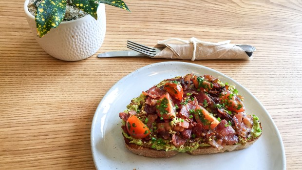 Kit Coffee at Westcliff Plaza in Newport Beach serves avocado toast with smoked bacon and cherry tomatoes. (Photo by Brad A. Johnson, Orange County Register/SCNG)