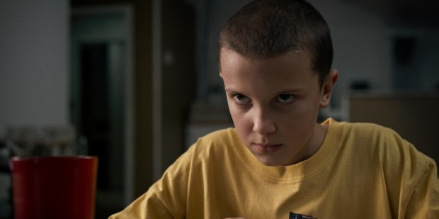 "This image released by Netflix shows Millie Bobby Brown in a scene from ""Stranger Things."" Brown was nominated for an Emmy Award for outstanding supporting actress in a drama series on Thursday, July 13, 2017. The Emmy Awards ceremony, airing Sept. 17 on CBS, will be hosted by Stephen Colbert. (Netflix via AP) ORG XMIT: NYET854"