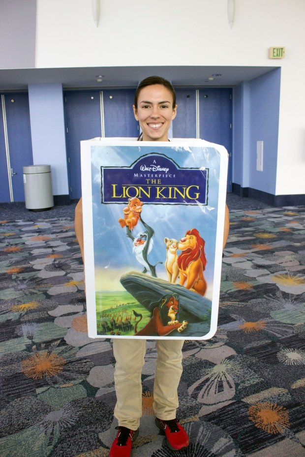 "Kayse Sheppard of Hacienda Heights, shows off her videocassette case costume for ""The Lion King."" (Photo by Mark Eades, Orange County Register/SCNG)"