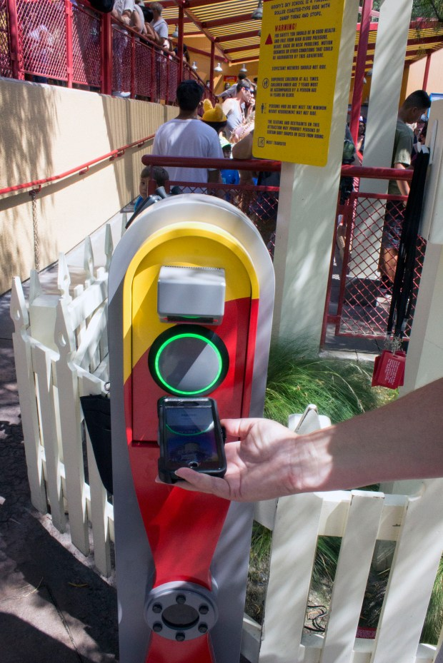 A smartphone with a Fastpass time via MaxPass, is scanned at a Disneyland Resort attraction. The light turned green on the scanner, indicating the Fastpass reservation time is valid. (Photo by Mark Eades, Orange County Register/SCNG)