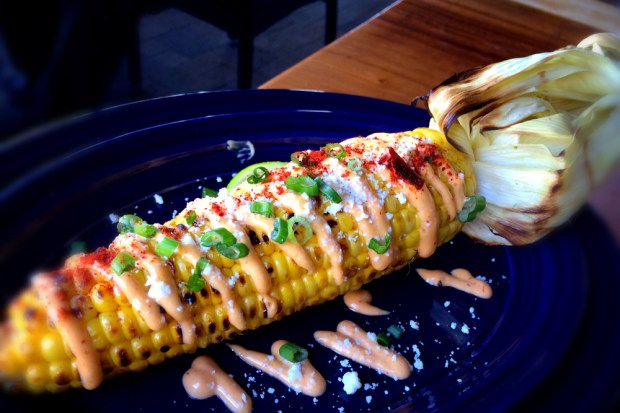 Corn is cooked over a wood-fired grill at Solita in Huntington Beach. (Photo by Brad A. Johnson, Orange County Register/SCNG)