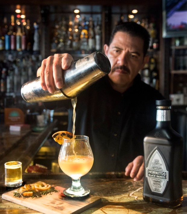 Bar manager Miguel Mora mixes a Table Side Old Fashion of Desmadre Anejo Tequila, Carazon Bitters, chocolate bitters with a splash of agave at Sol Agave, San Juan Capistrano. (Photo by Cindy Yamanaka, Orange County Register/SCNG)