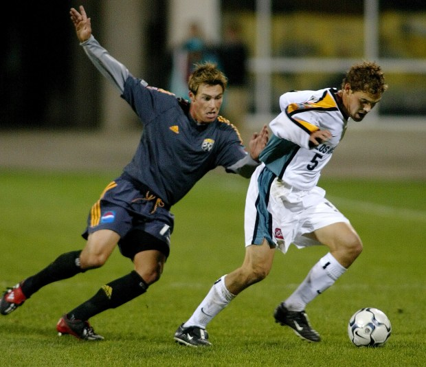 Los Angeles Galaxy's Chris Albright (5) dribbles the ball up field as Columbus Crew's Brian Dunseth defends during the first half of the U. S. Open Cup Championship at Crew Stadium Thursday Oct. 24, 2002 in Columbus, Ohio. (AP Photo/Jay LaPrete)