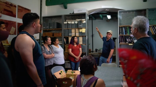 Julián Jefferies, professor at Cal State Fullerton and coordinator of the Puerto Rico International Education Program, shows students the archive at the Museo Fuerte Conde de Mirasol, where students volunteered. (Photo courtesy of Alicia Afshar)