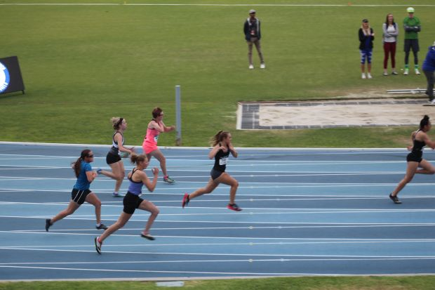 Cross shown here competing at the National Meet at UCLA, where she brought home two silver medals and one gold medal (Photo courtesy of Emily Cross).