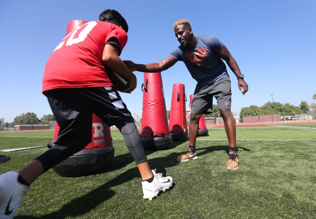 Shareece Wright, NFL defensive back, and Colton and USC alum, runs kids through drills during his first free kids football camp on Friday, July 21, 2017 at Colton High School. (Stan Lim, The Press-Enterprise/SCNG)