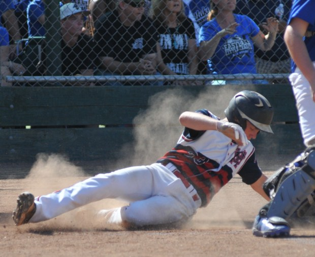 Santa Margarita National's Bobby Gray slides across home plate with what turned out to be the winning run in SMNLL's 9-8 victory over Eastlake in the Southern California Divisional Little League tournament played Sunday, July 23, in Long Beach. Photo Courtesy of Lou Ponsi