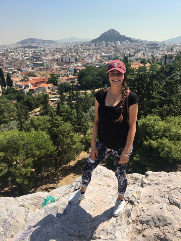 "Cal State Fullerton student Talia Jankowski stands on Mars Hill, also known as the Areopagus, in Athens, Greece, where the Apostle Paul preached, ""Now what you worship as something unknown I am going to proclaim to you."" (Photo courtesy of Talia Jankowski)"