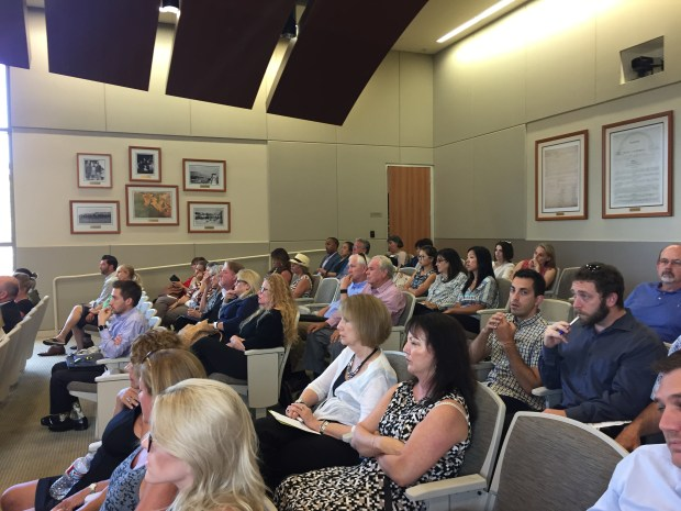 Community members listen to a single-payer health care panel discussion at Laguna Niguel City Hall on Thursday, July 27. (Emily Rasmussen, contributing photographer)