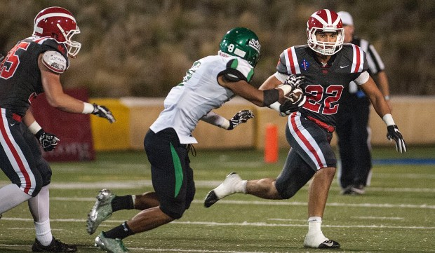 Mater Dei senior Elijah Blomquist runs the ball during a game against Upland in 2016. Blomquist was not able to secure an athletic scholarship despite signing a contract with Playing for Envelopes, a recruiting service. (Photo by Nick Agro, Orange County Register/SCNG)