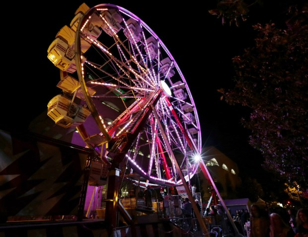 Visitors ride the Ferris wheel during the 24th annual Festival of Lights at the Riverside Main Street mall in 2016./File photo by Frank Bellino, The Press-Enterprise/SCNG