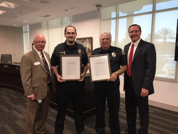 GRF Director Tom Sirkel (far left) and Security Chief Tim Moy (far right) award commendations to security officers Ernesto Lupercio (near left) and Peter Di Bartomeo for their work in helping nab a gaterunner. (Photo by Emily Rasmussen, contributing photographer)