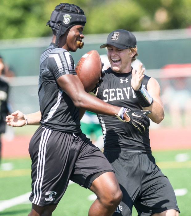 Servite quarterback TJ McMahon, right, celebrates a touchdown during the Battle at the Beach seven on seven football tournament at Edison High School in Huntington Beach on Saturday, July 8, 2017. (Photo by Matt Masin, Orange County Register, SCNG)