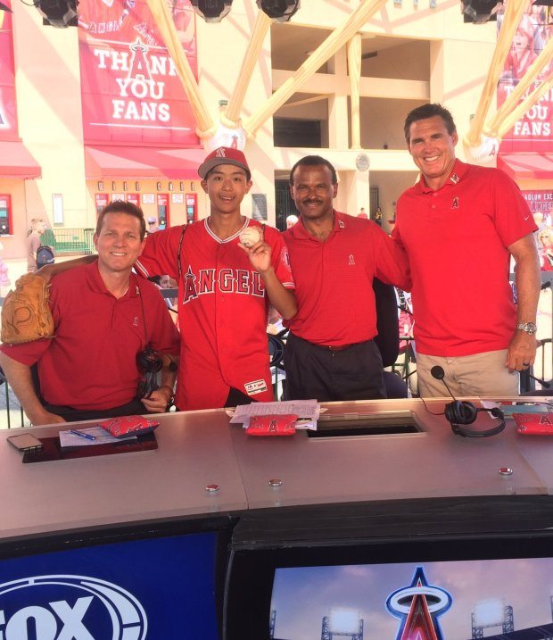 Angels fan Fergus Chan, of Hong Kong, second from left, poses with Fox Sports announcers Patrick O'Neal, Jose Mota, Tim Salmon after catching Mike Trout's home run on Sunday, June 23. (Photo courtesy of Fergus Chan)