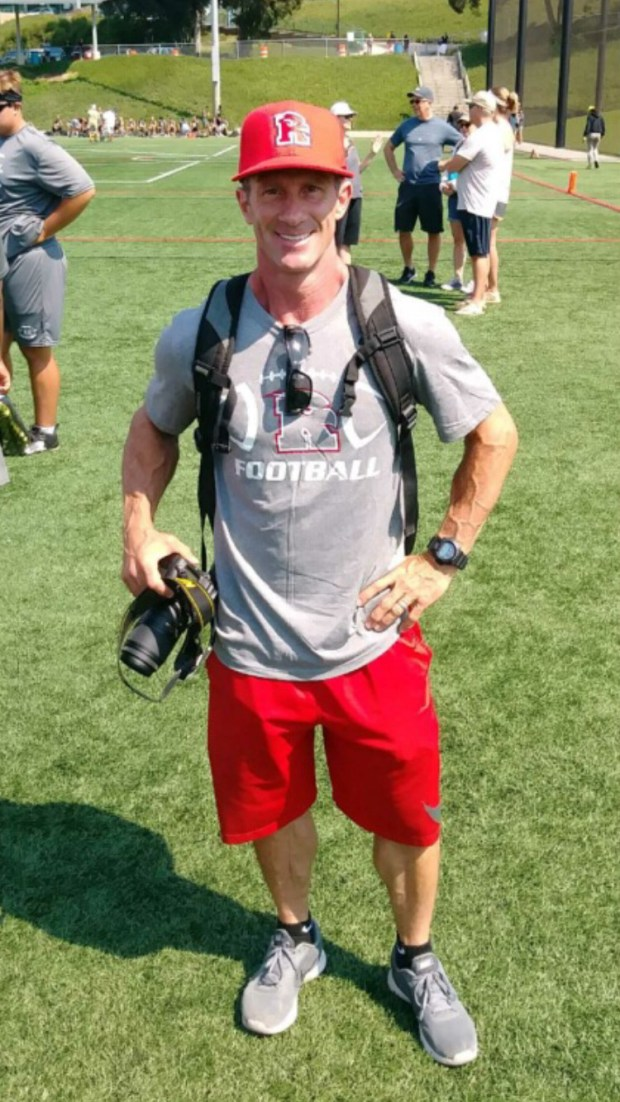 Strength coach Jay Scully poses for a picture on the football field at Redondo Union High School. He just found our last weekend at the Redondo Passing Tournament that he has a doppelganger - Rancho Verde football coach Jeff Steinberg.