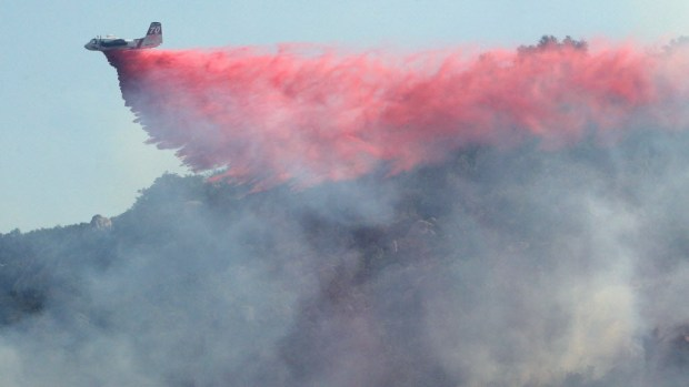 A air tanker makes a drop on a wildfire on the hillside just south of Temecula in this May 2016 file photo.