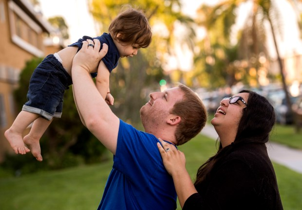 James and Gaby Berreth play with their 9-month-old son Luke in Anaheim on Tuesday, August 8, 2017. Gaby took 8 weeks of pregnancy leave after her caesarian delivery. They could not afford to take additional baby bonding time off. Their jobs would not have been protected since their employer was a company with fewer than 50 employees. (Photo by Paul Rodriguez, Orange County Register/SCNG)