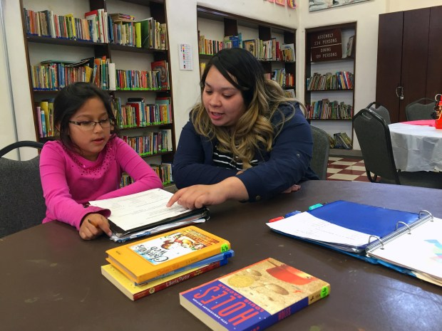 Friendly Center volunteer tutor Maddie Cuevas works with a student in the Success for All after-school tutoring program. (Courtesy Friendly Center)