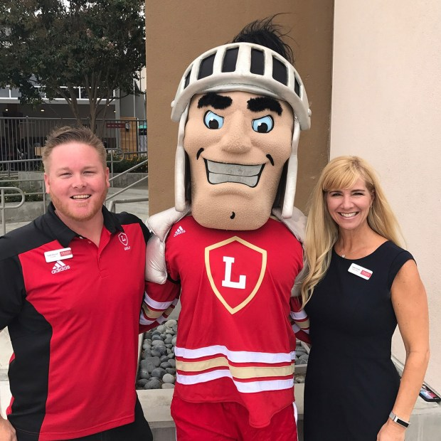 Orange Lutheran High School Principal Todd Eklund, and Head of School Leslie Smith, plus mascot Ollie welcome 1,300 students on their opening day of school. (Courtesy OLu)